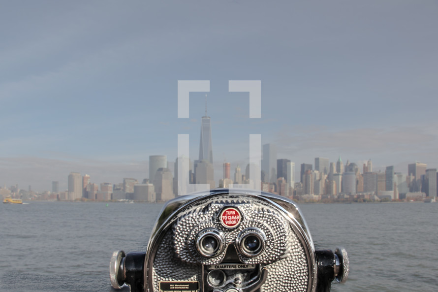 a viewfinder scope looking out at a city