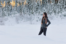 a woman standing in deep snow