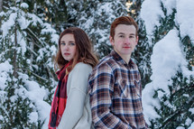 young couple standing outdoors in snow