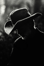 Silhouette of a man in a cowboy hat.