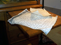 A hand written letter like the letters that Paul wrote to the churches in the New Testament or a personal letter or manuscript hand written in cursive writing.
