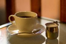 coffee cup, spoon, creamer