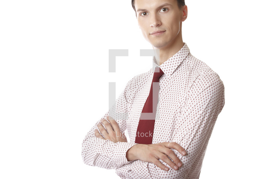 portrait of a businessman with arms across his chest