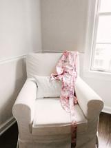 silk robe on a white arm chair