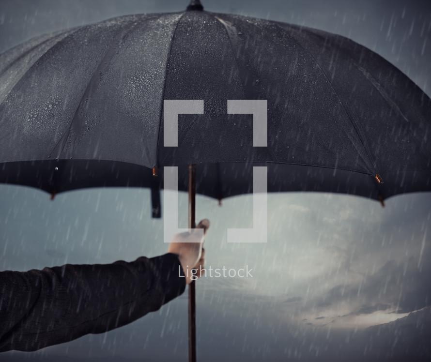 a man holding an umbrella in the rain