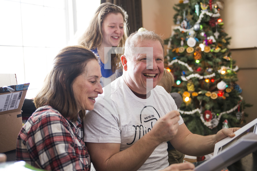 a family opening christmas presents