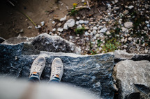 feet of child standing on a rock