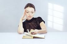 a woman flipping through a book