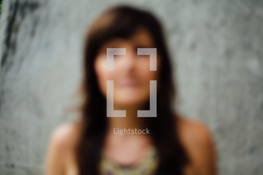 blurry image of a woman