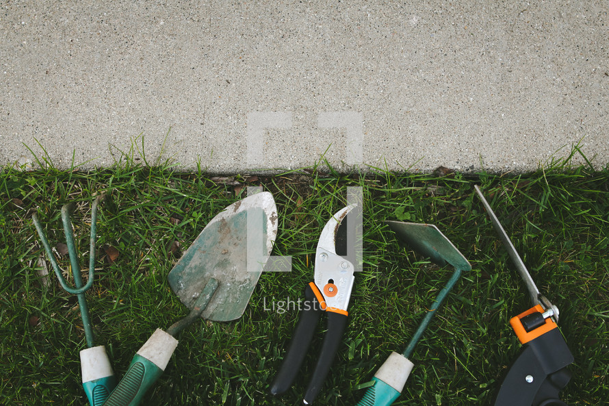 gardening tools in the grass
