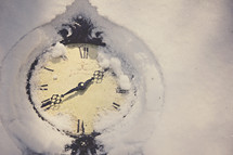 A clock covered in snow.