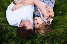 couple lying in the grass