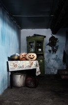 jack-o'-lanterns in a dark room