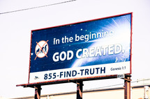 In the beginning God created. 855-FIND-TRUTH Genesis 1:1 billboard sign