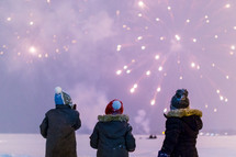 kids watching fireworks in the snow