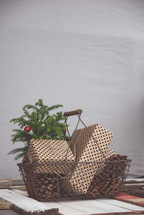 pine cones and presents in a basket