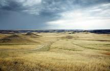 rural road through rolling hills of a prairie