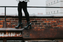 balancing in heels on a roof