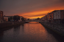 bridge over a river canal at sunset