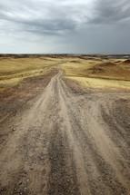 dirt road over rolling hills