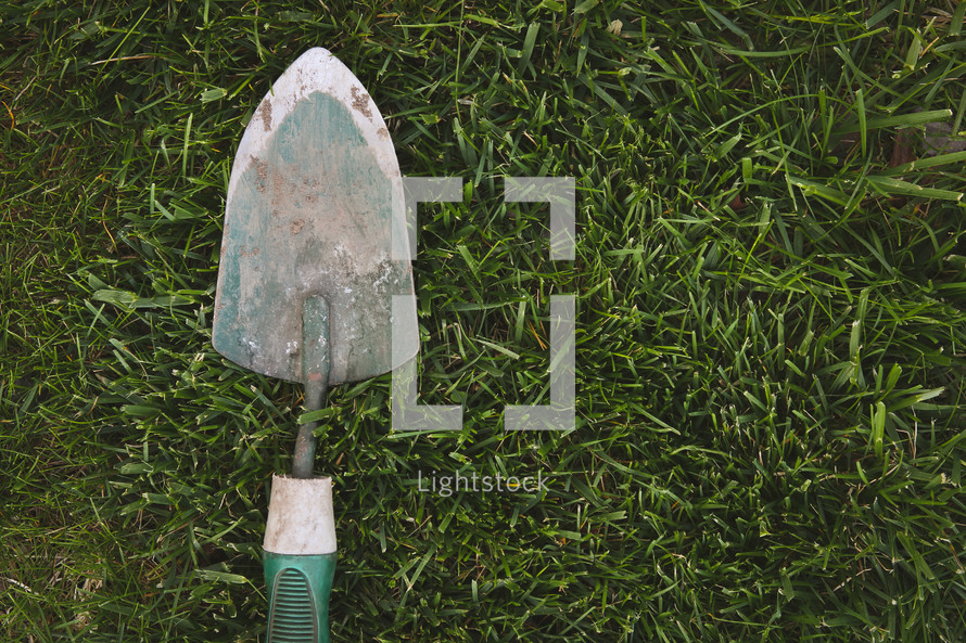 a shovel in the grass