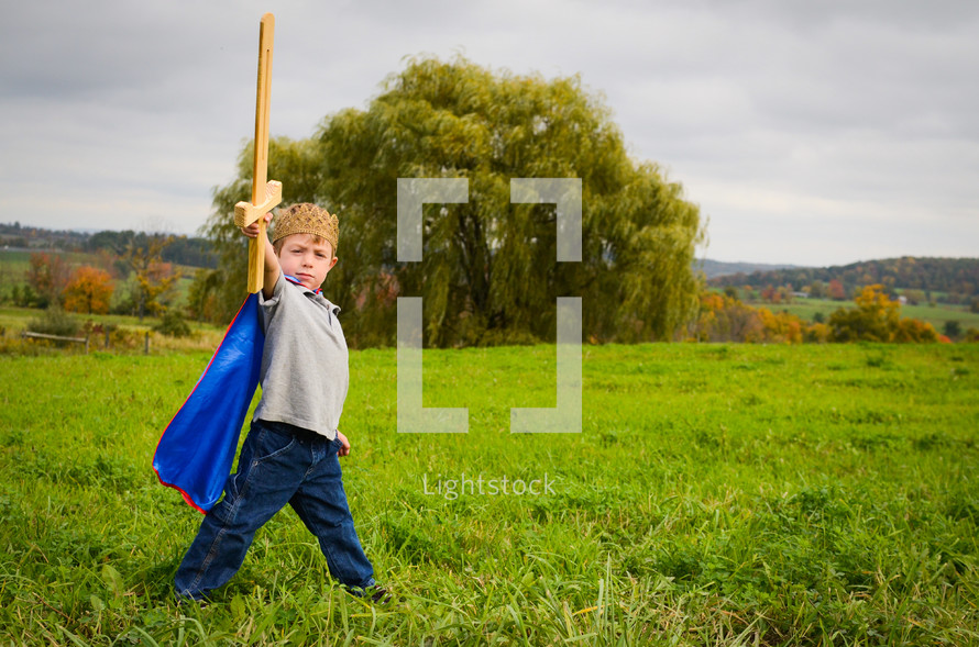 a boy child with a sword