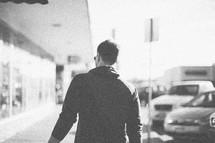 A man walking down the sidewalk