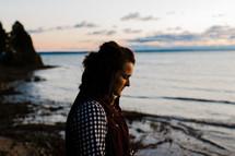 woman praying by a shore
