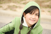 girl child with pigtails in a hoodie
