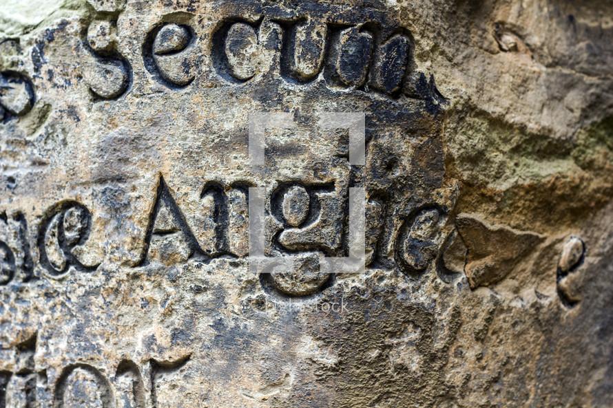 Latin carved in stone