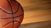 basketball on a wooden basketball court