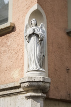 angel statue at the corner of a building