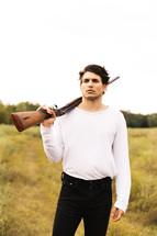 a man with a shotgun