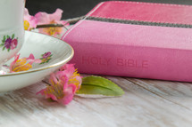 Pink Bible and floral coffee cup
