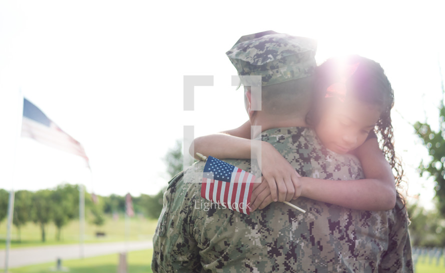 soldier hugging his daughter