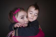 siblings hugging