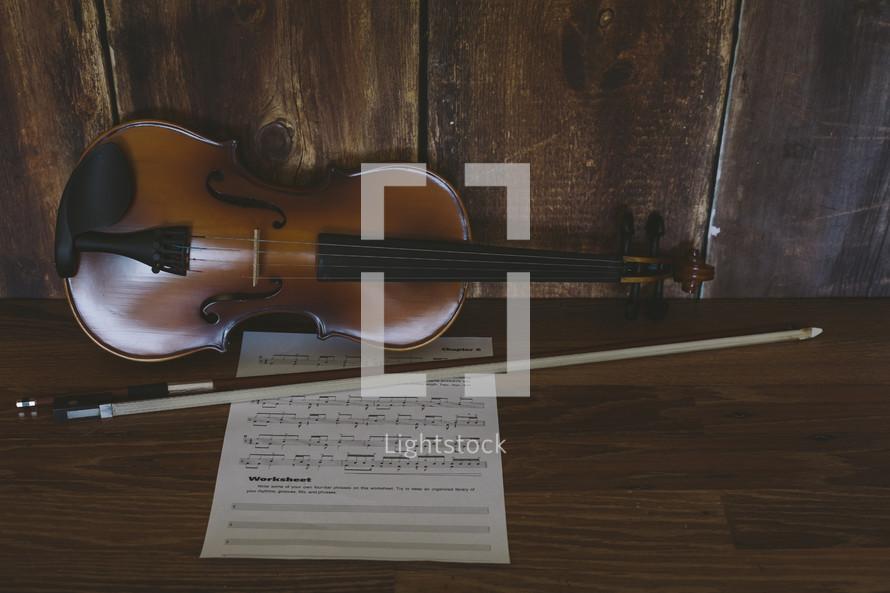 a violin, bow, and sheet music