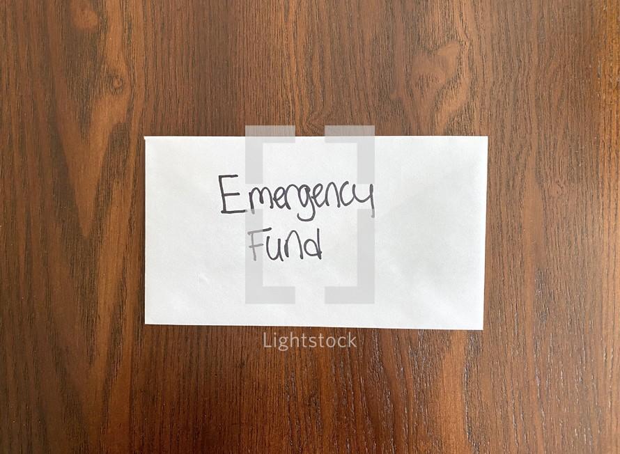Emergency fund - money in an envelope