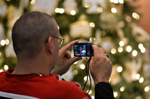 Father photographing his daughter at a Christmas program at Union Chapel United Methodist Church, Albemarle, North Carolina, December, 2013