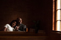 husband and wife in church pews