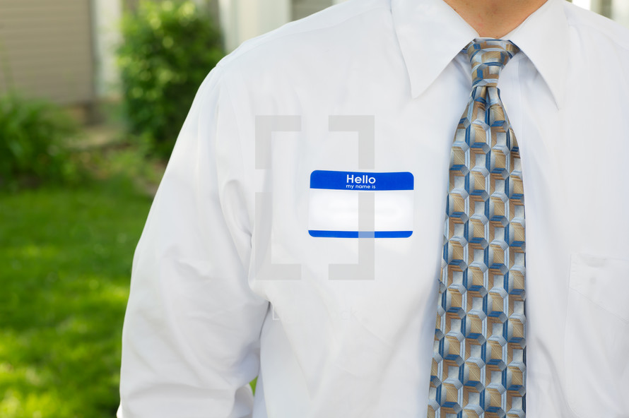blank name tag on a man