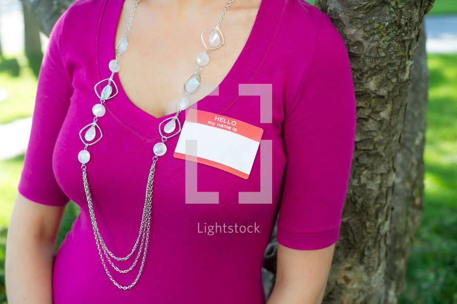 blank name tag on a woman