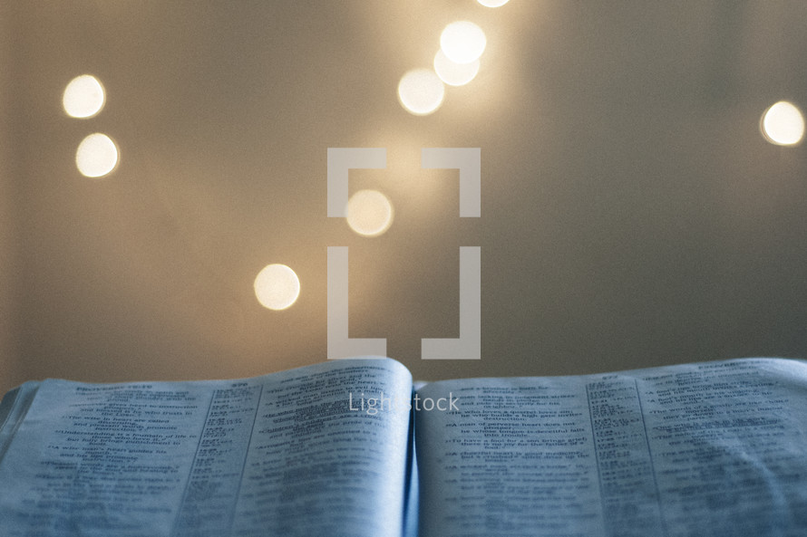 bokeh lights and an open Bible