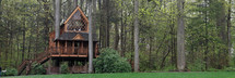 Large treehouse in a forest.