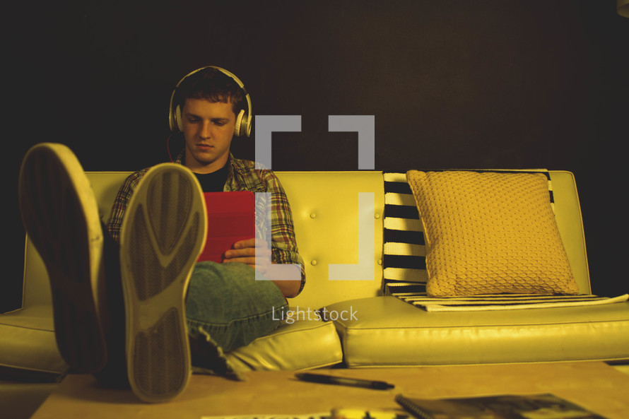 teenager listening to headphones
