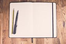 pens on an open journal