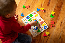 a toddler playing with a puzzle
