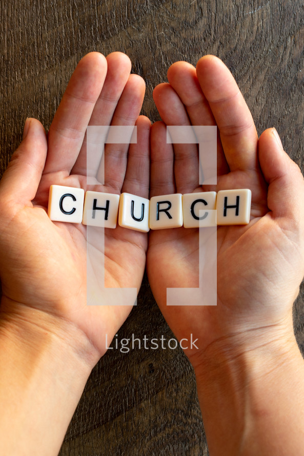 cupped hands with the word church