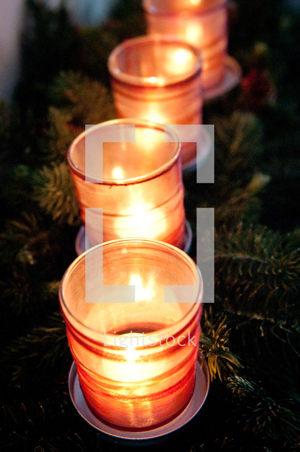 A Christmas centerpiece with candles.