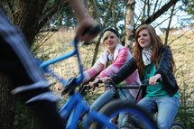teen girls riding bikes
